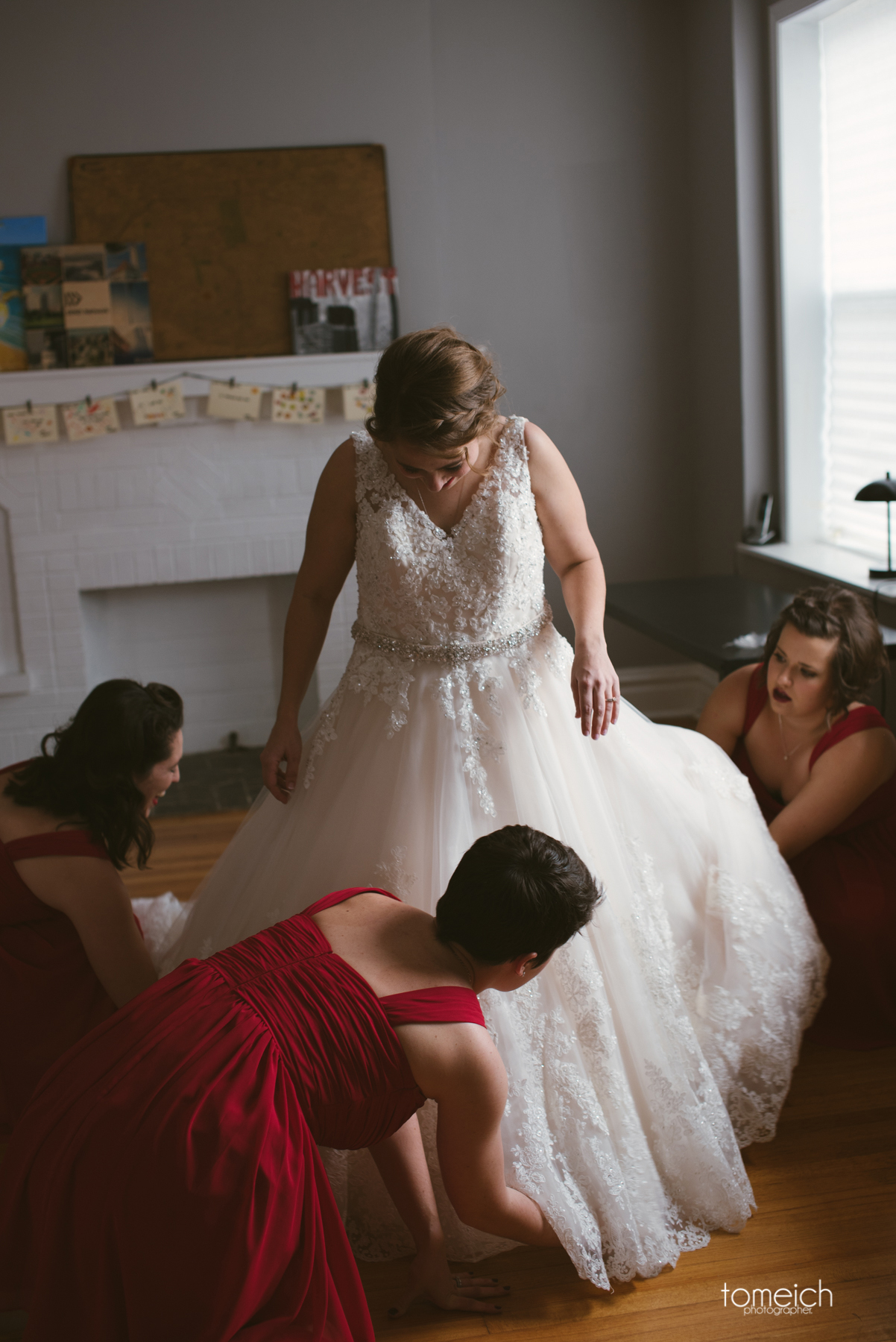 bridesmaids working on the dresss