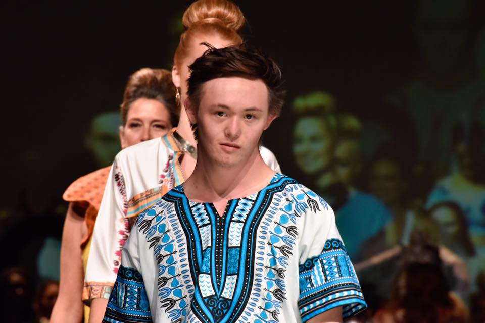 "Fashion ART Santa Cruz modeling African clothes as the first model with Down Syndrome.  Does you ever get nervous? ""Never"", says Brandon"