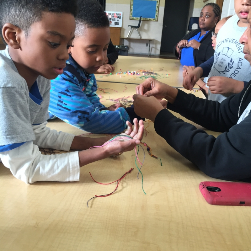 Students make friendship bracelets to give to friends to show compassion.