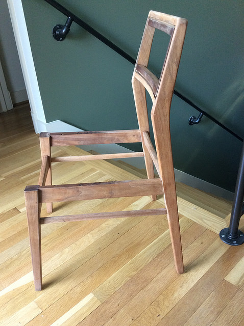 A chair that's been disassembled, sanded, glued up, and is ready for a light sanding and finish.