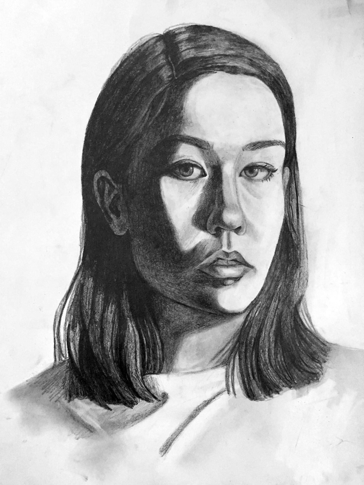 "Media: graphite on paper  Size: 18""x24""  Date: Spring 2016  Course Name: Perceptual Drawing  Assignment: Self Portrait from Life  Level: 2000"