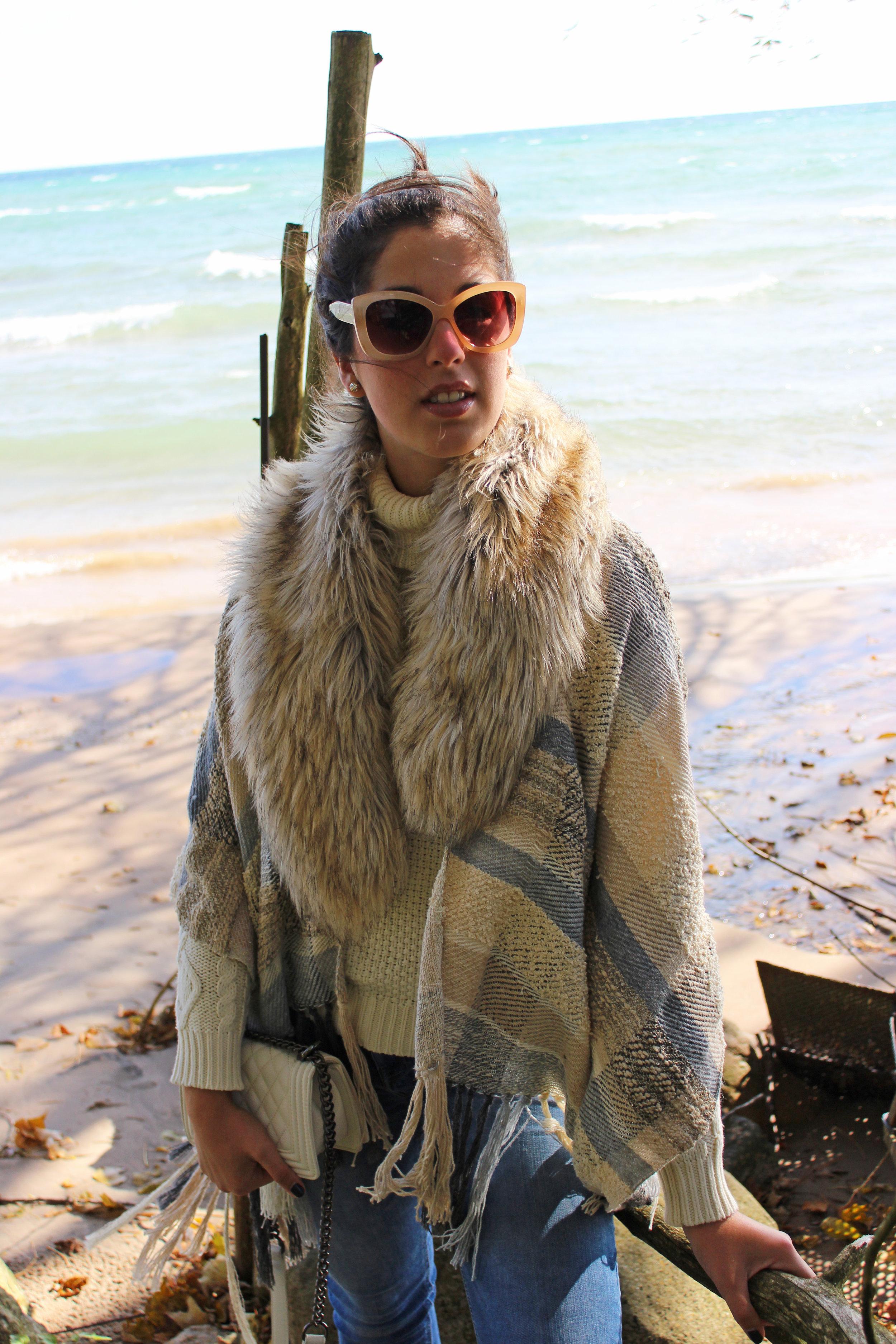 Madalyn Manzeck photographed by   Cassie Sterwald  in her backyard on Lake Michigan in 2016.    Poncho  Madalyn Joy Designs  // Turtleneck Sweater (similar) Ralph Lauren  // Faux Fur Stole (similar)  Anthropologie  // Jeans (similar)  Zara  // Heels (similar)  Madden Girl  // Earrings  Kate Spade  // Shoulder Bag  Forever 21  //  Nail Colour Taken By Storm Atlantic Pacific x Formula X
