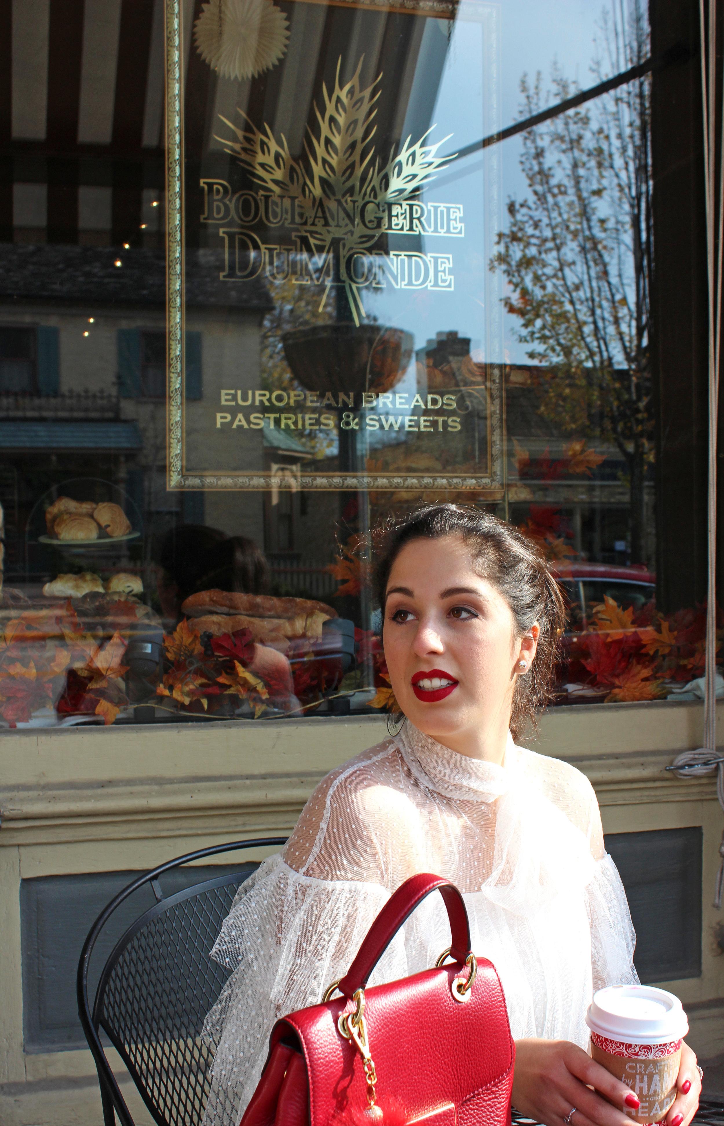 Madalyn Manzeck photographed by  Cassie Sterwald  in downtown Cedarburg in 2016.  Dress  Dezzal  // Handbag  Michael Kors  (in black)// Shoes Aldo // Earrings  Kate Spade  // Lipstick  Stila