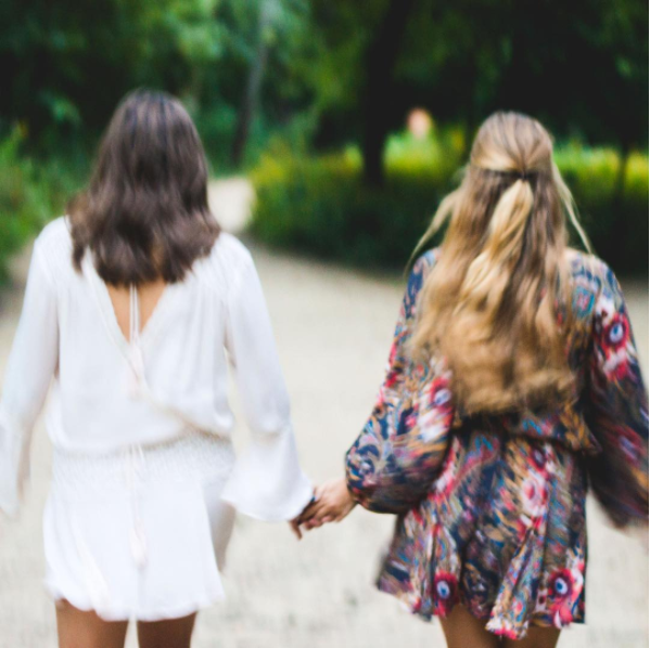 """""""Morgan and I love fashion. Clothing is just one thing we bond over. Sometimes she is a little bit more preppy, and I am little bit more rocker, but we both love dressing in the boho fashions of Free People. The link below will bring you to an Instagram of the two of us in beautiful, light weight dresses. The out of focus shot resembles the dream like quality of Free People's clothing. As the first snow sets in and finals loom around the corner, I wish we could go back to this carefree summer day."""" -Ashley Mackens"""