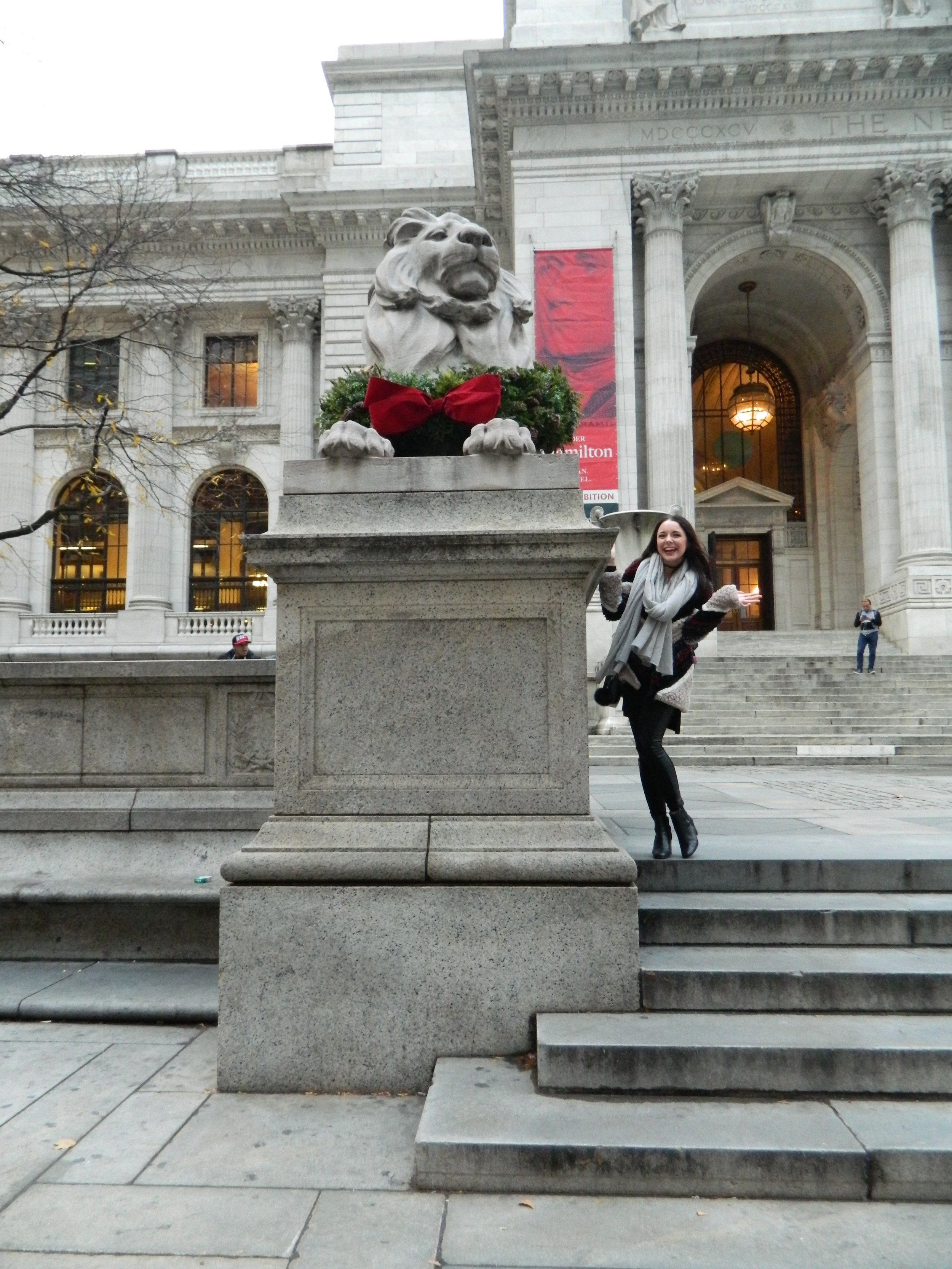 Courtney posing in between the lions at the New York Public Library
