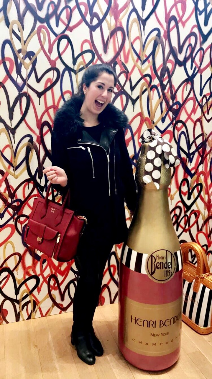Madalyn in her happy place shopping at Henri Bendel