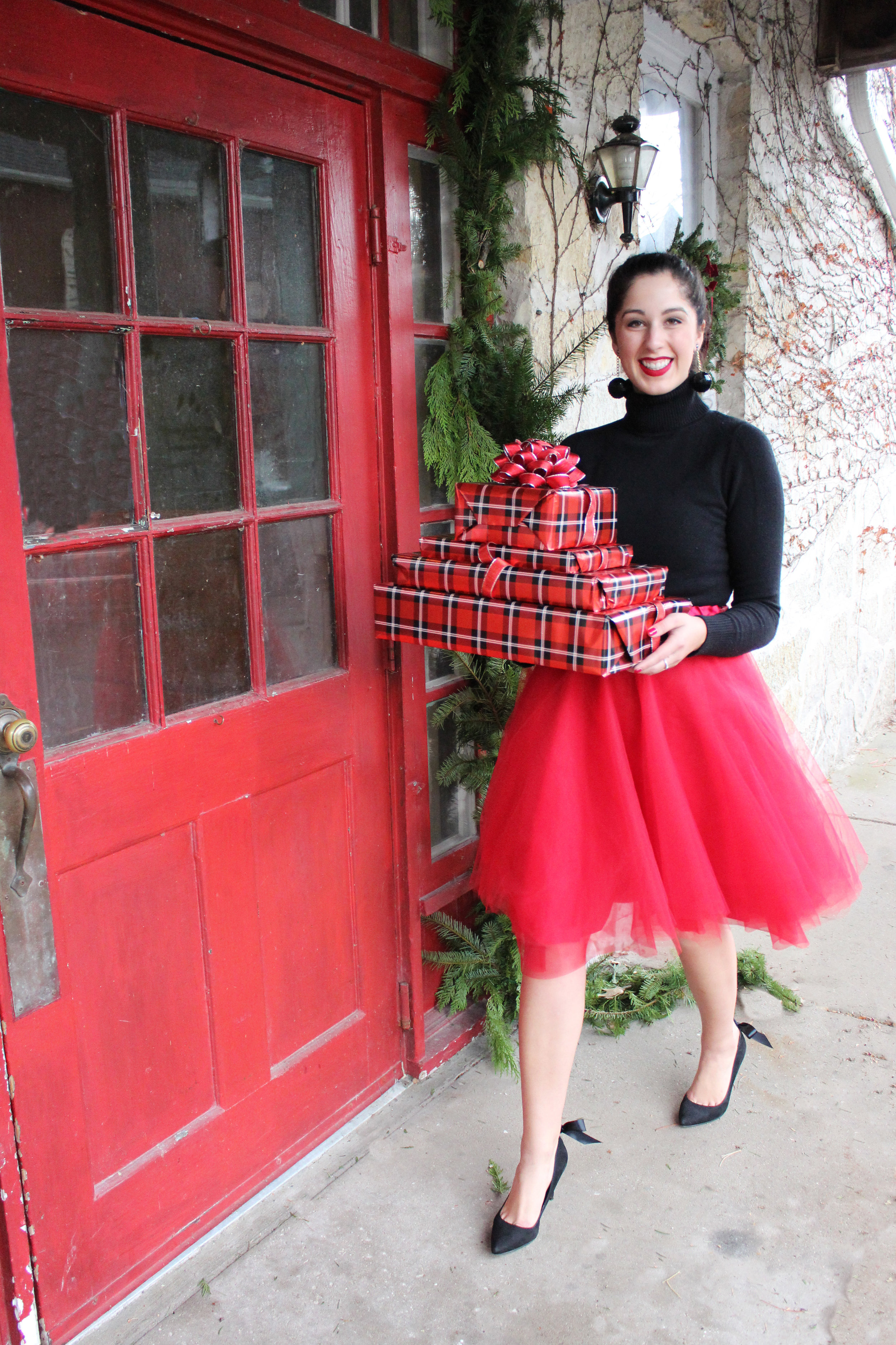Madalyn Manzeck photographed by Cassie Sterwald in Cedarburg, WI in 2016.   Red tulle skirt Madalyn Joy Designs | Black turtleneck sweater French Connection | Black bow heels Aldo | Red heart flats Christian Louboutin | Vintage black sequin earrings | Red matte lipstick Stila