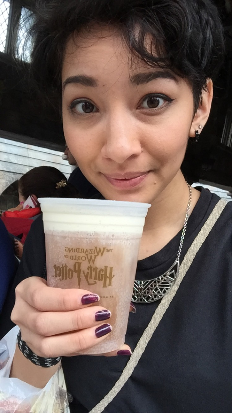 Vanali enjoying her cup of Butter Beer, a creamy butterscotch soda, at Harry Potter World in Orlando, FL.