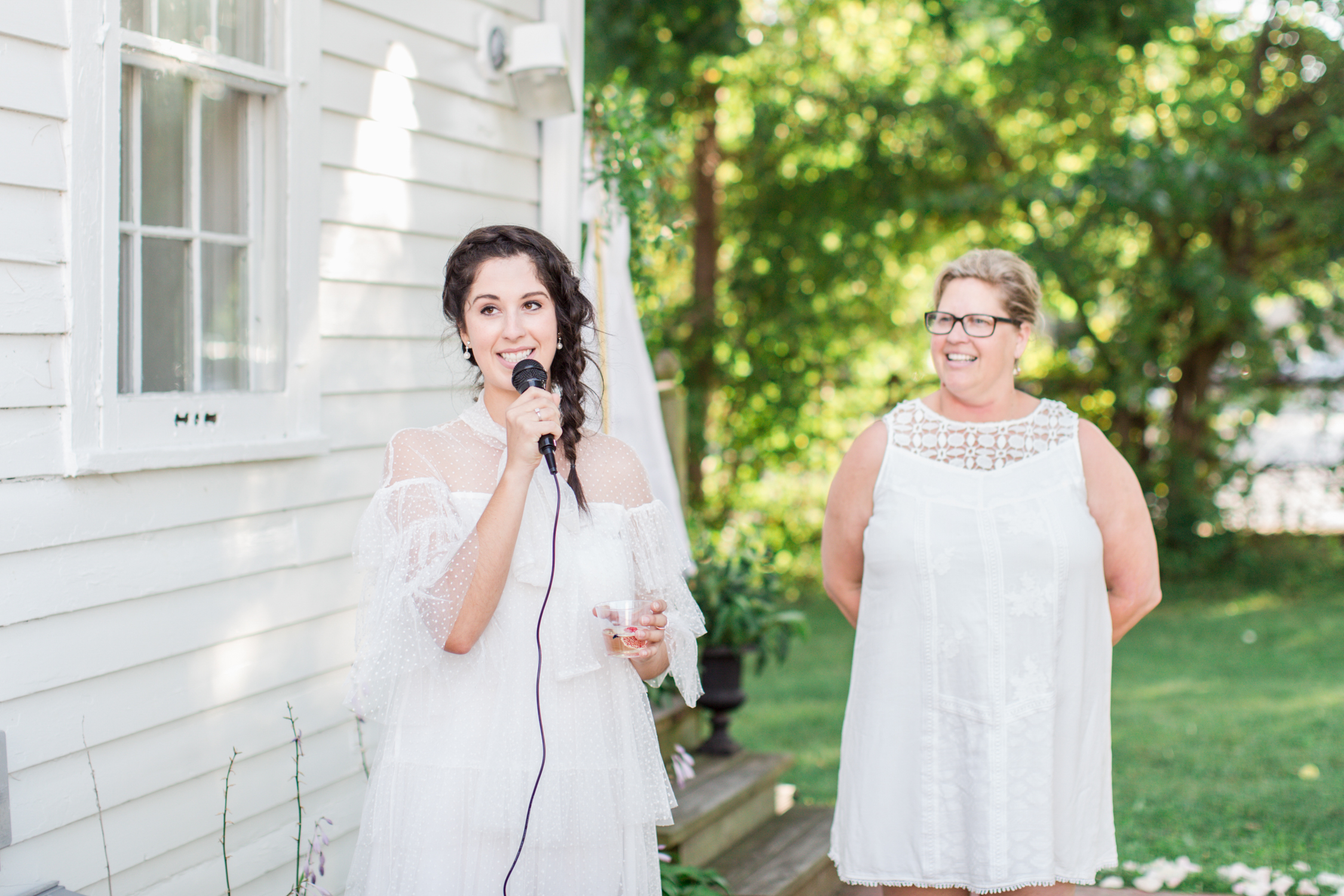 Madalyn Manzeck of Madalyn Joy Designs and Vicki Kunz of La Tulipe welcoming the guests to their garden party.