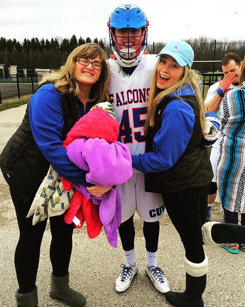 Claire and her best friend, Hayley, posing with Colin after one of his lacrosse games.