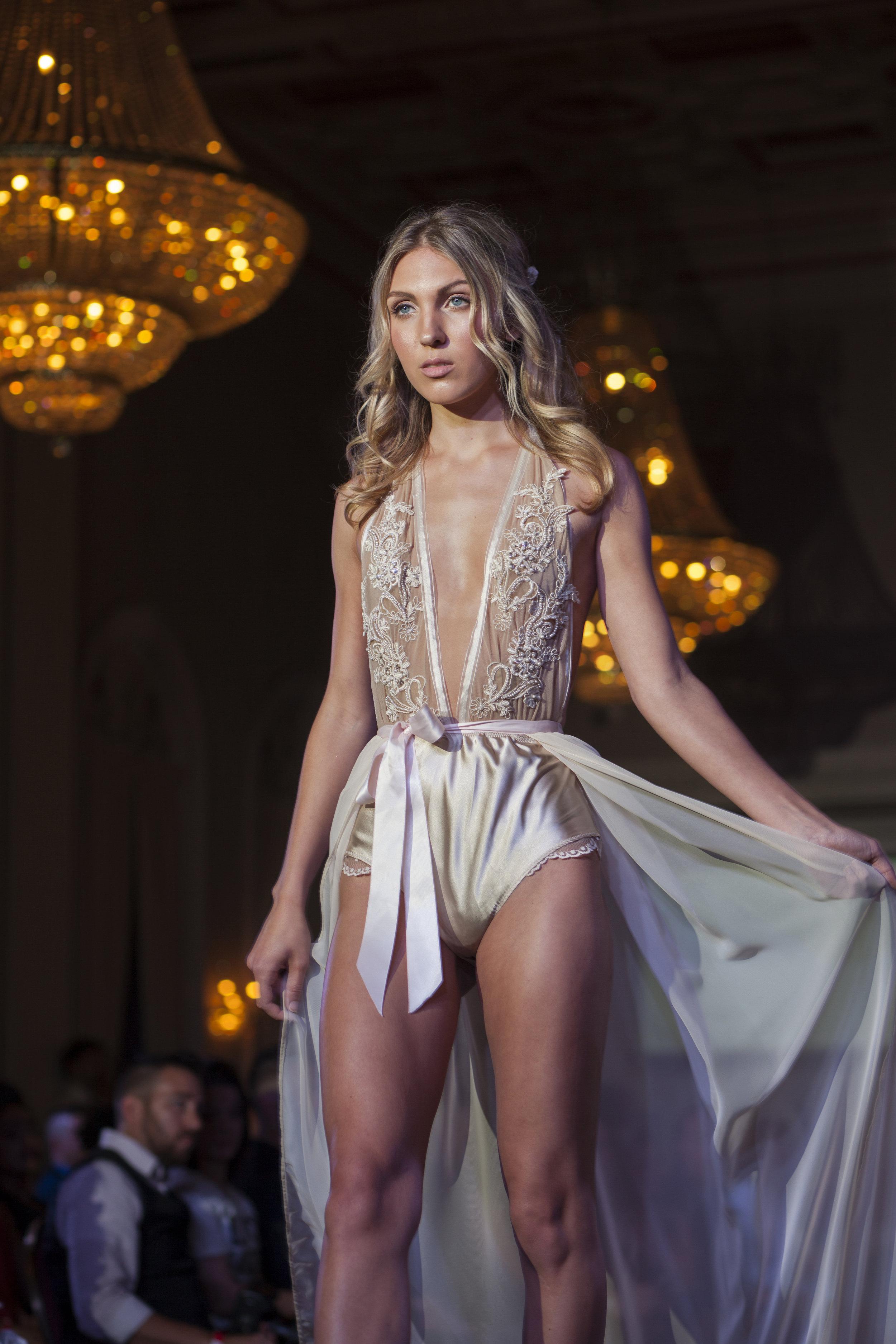 Jessica Marie Webber glistens like a golden goddess on the runway.
