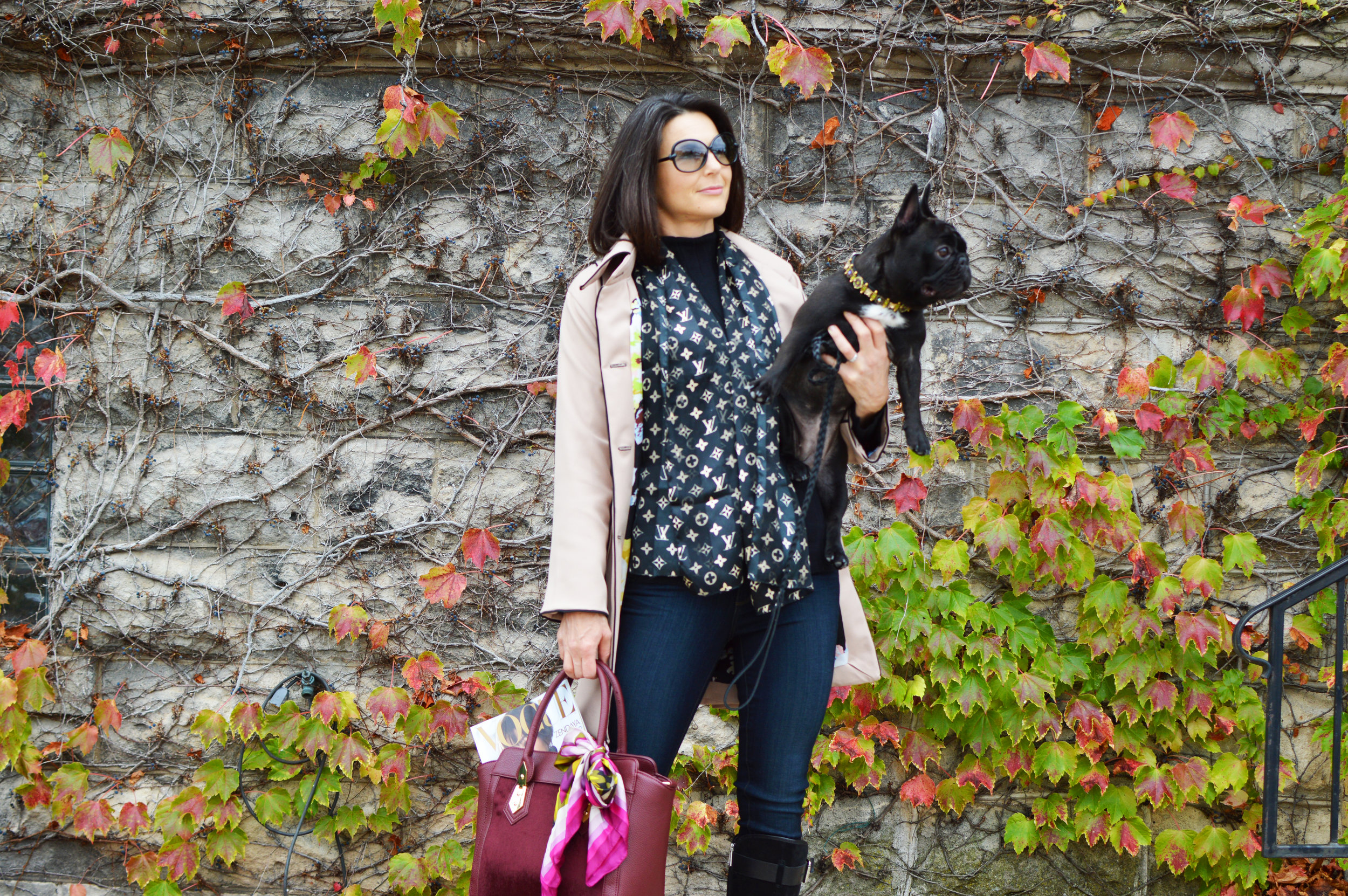 Carrie Tate wearing a custom Madalyn Joy Designs trench coat holding her sweet pup, Ruby, photographed by Kortney Manzeck in Port Washington, WI. 2017.