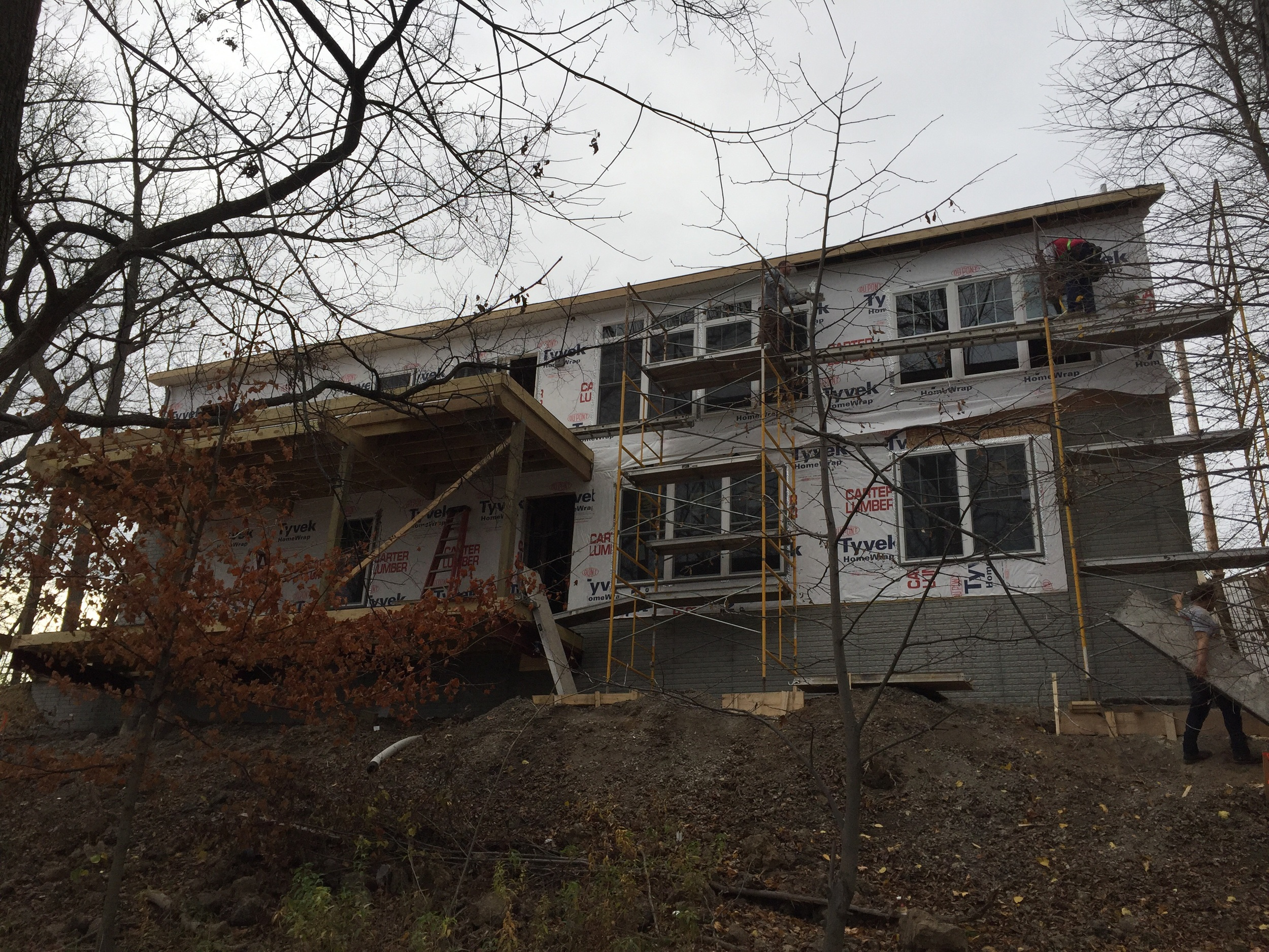 With second story eaves close 25' off the ground and built into a shear cliff, this build was not for the faint of heart.