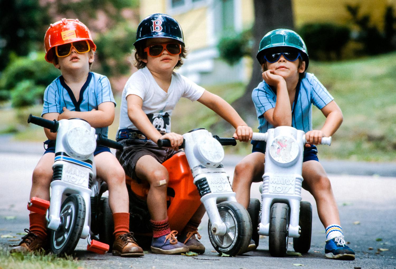 Boys-In-Helmets-And-Sunglasses-On-Three-Wheelers.jpg