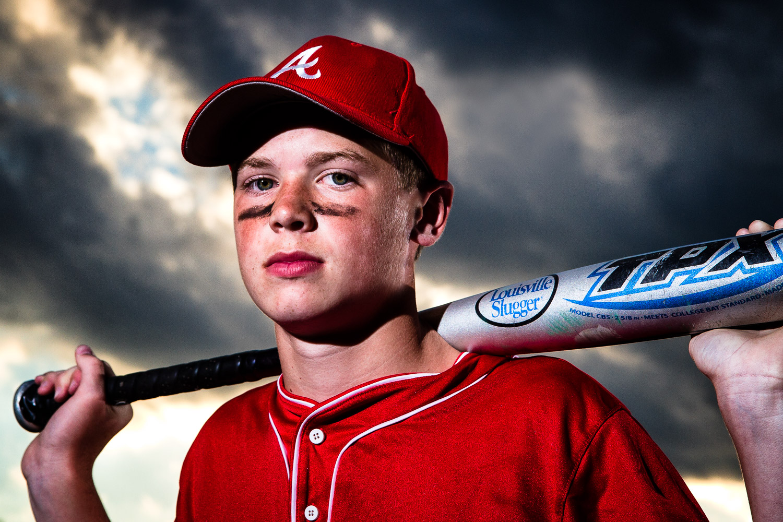 Baseball-Player-With-Bat-Over-Shoulders.jpg