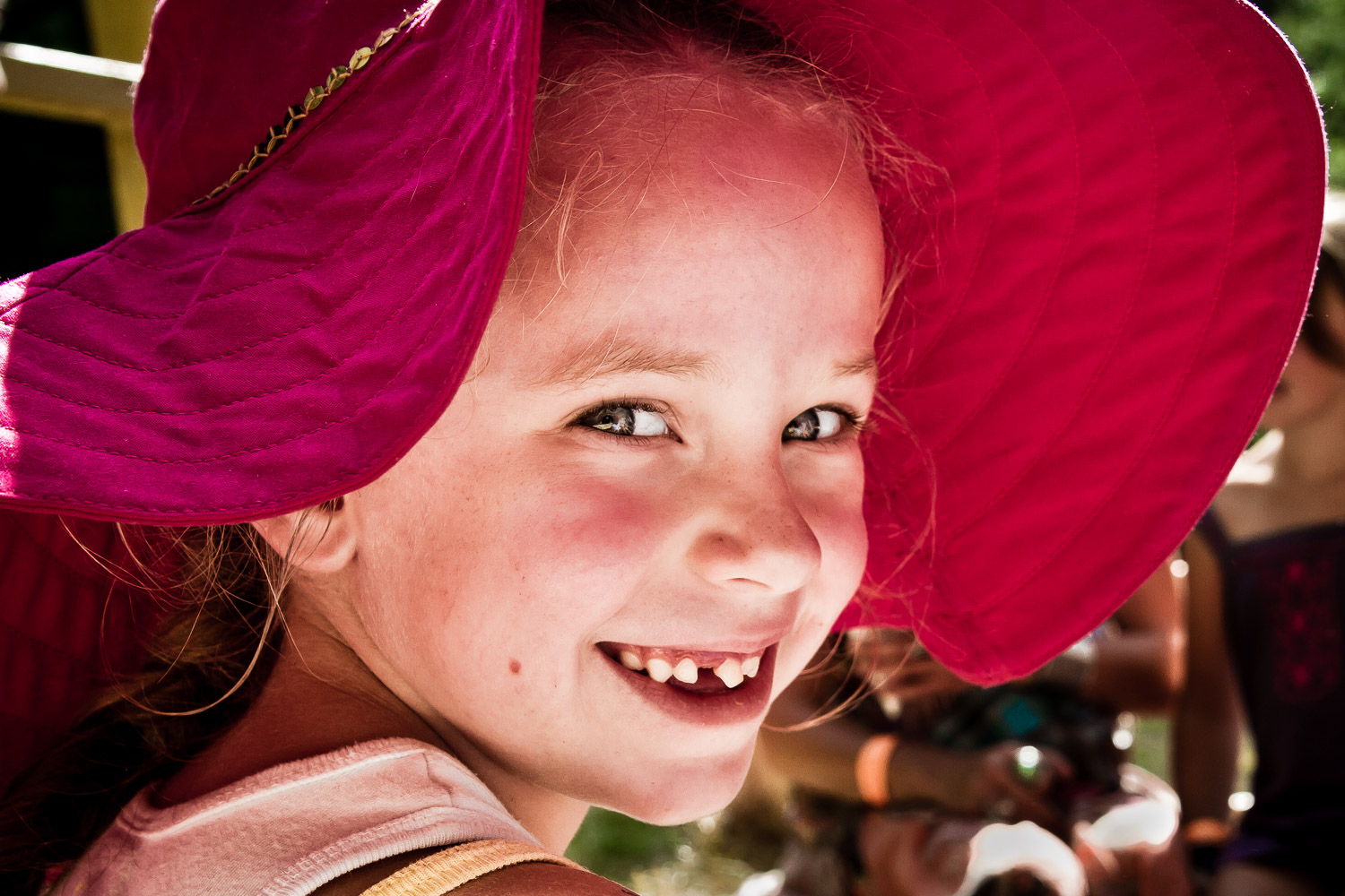 Young-Girl-In-Floppy-Red-Hat-Missing-Tooth.jpg