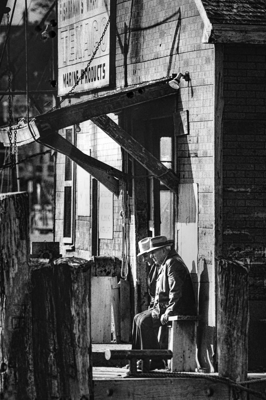 Older-Men-In-Hats-Sit-Outside-Pier-Store.jpg