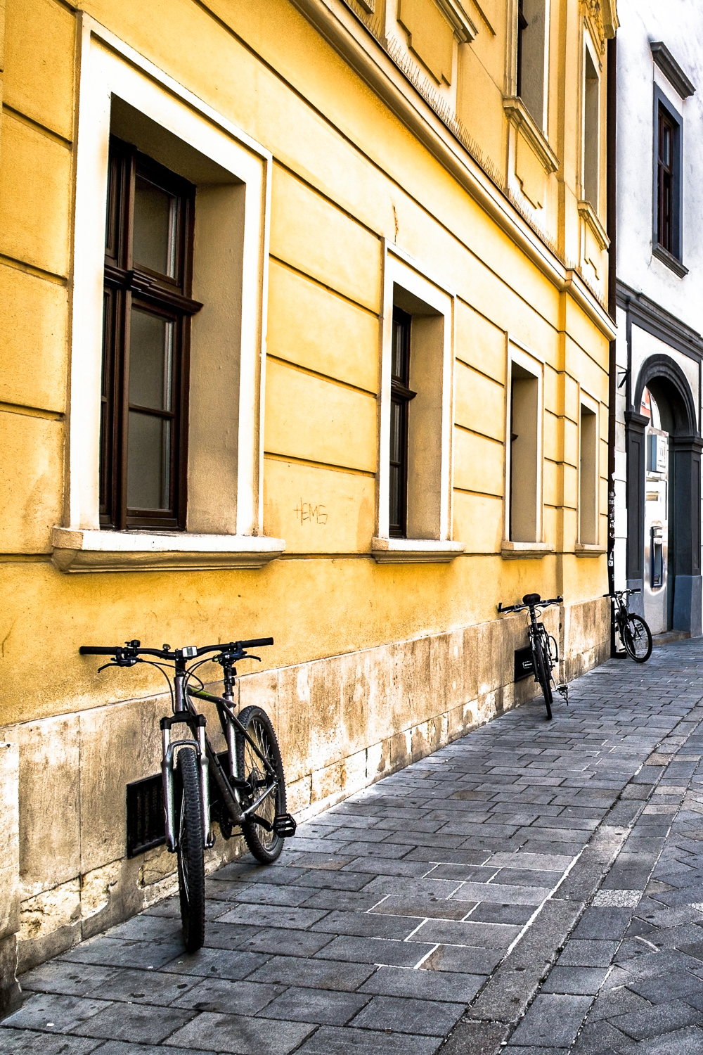 Bratislava-Bicycles-Against-Building-Street.jpg