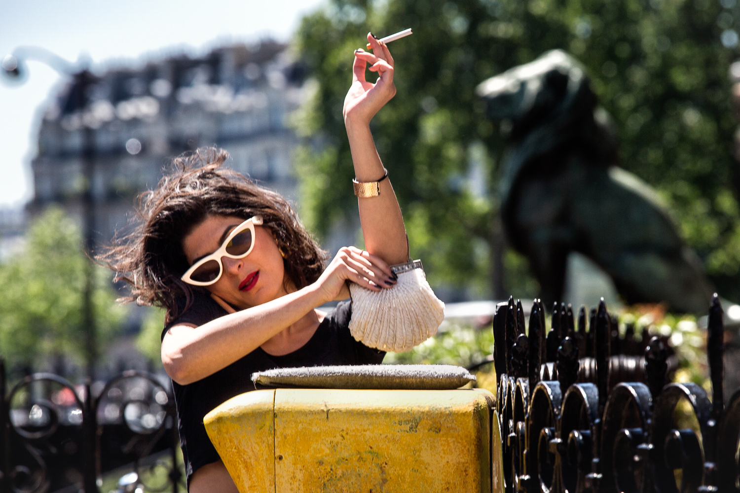 Woman-Cigarette-Handbag-Phone-Sunglasses-Statue.jpg