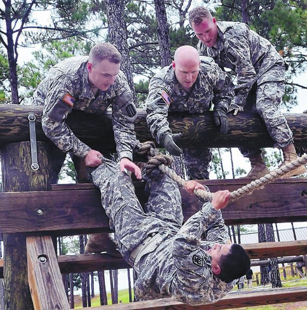 Photo Credit: LTC Sonise Lumbaca. Soldiers from the 197th Infantry Brigade participate in an adaptability practical exercise using an obstacle course during the Asymmetric Warfare Group's Asymmetric Warfare Adaptive Leader Program hosted at Fort Benning, Ga. November 2012.