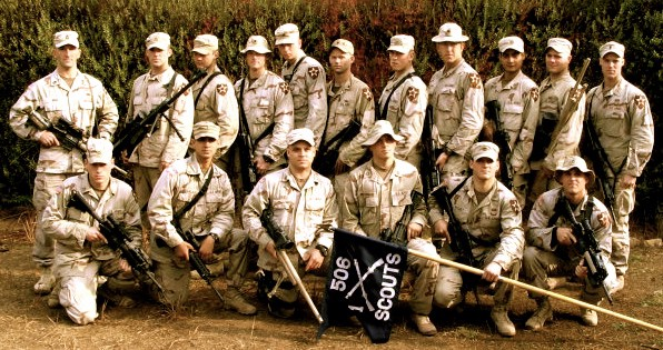 Justin and his platoon at the end of his first deployment. Justin is standing in the back row, fifth from the right.