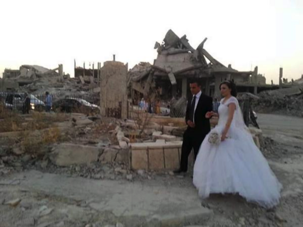 Photo by Yaser Beyro, depicts Kurdish wedding in Kobani, Syria.
