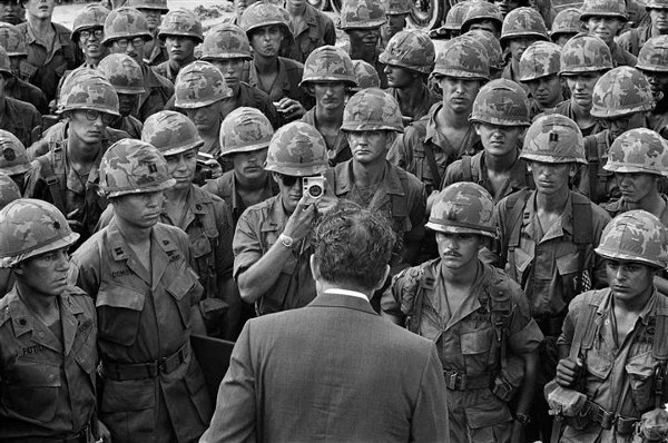 A GI gets a closeup photo as President Nixon meets with troops of the 1st Infantry Division at Di An, 12 miles northeast of Saigon, on his eighth visit to South Vietnam and his first as president, on July 30, 1969.