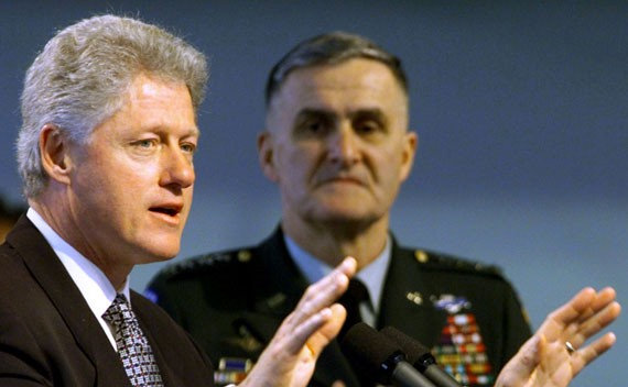 U.S. President Bill Clinton beside Gen. Hugh Shelton, then chairman of the Joint Chiefs of Staff, explaining the U.S. and NATO mission in Kosovo on April 1, 1999. (Win McNamee/Reuters)