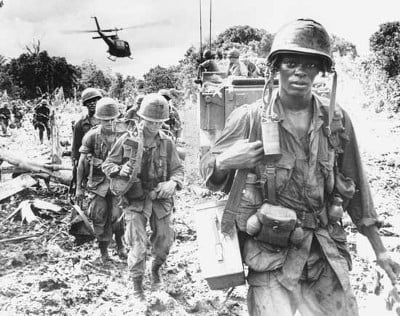 U.S. soldiers on a search-and-destroy patrol in Phuoc Tuy province, South Vietnam, June 1966 (U.S. Army Photo)
