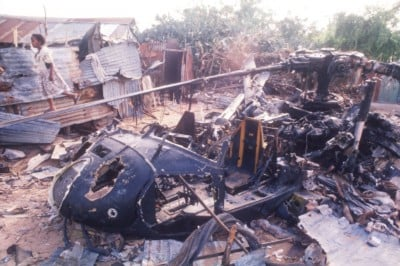 A child walks near the wreckage of an American helicopter in Mogadishu, Somalia on October 14, 1993. (Scott Peterson/Liaison, Getty)