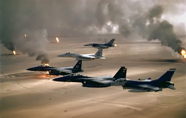 USAF aircraft of the 4th Fighter Wing (F-16, F-15C and F-15E) fly over Kuwaiti oil fires, set by the retreating Iraqi army during Operation Desert Storm in 1991. (U.S. Air Force photo / Wikimedia Commons)