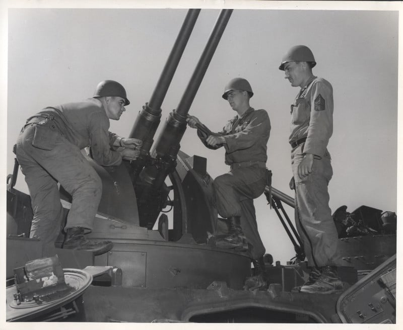 """Guardsmen conducting maintenance on their M42 """"Duster"""" mobile anti-aircraft piece (Author's collection)"""