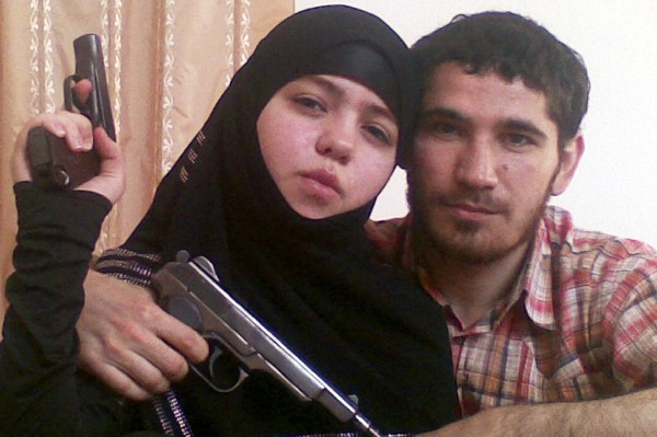 """Dzhennet Abdurakhmanova, 17, posing with her late husband Umalat Magomedov. She became a """"black widow"""" and graduated to suicide bomber, carrying out the Moscow subway bombings in April 2010."""