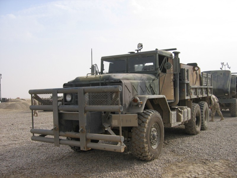 A U.S. Army 5-ton cargo truck with improvised armor on the doors, rear gunner's box, and an improved bumper. (Photograph taken by Jeff McFall at LSA Adder, Iraq)