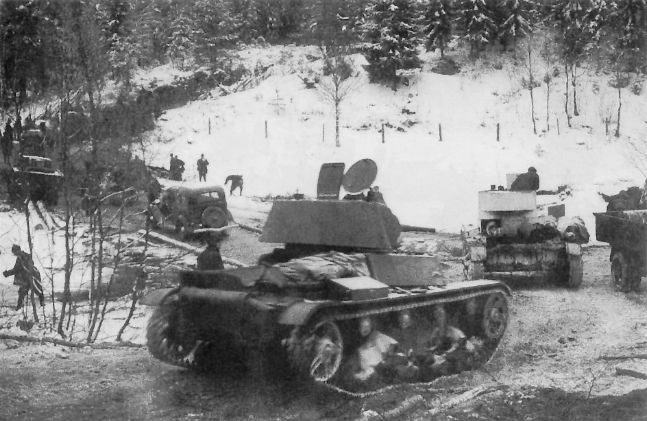 Soviet T-26 light tanks and GAZ-A trucks of the Soviet 7th Army during its advance on the Karelian Isthmus, December 2, 1939. (Wikimedia Commons)