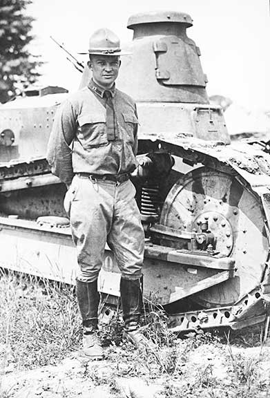 Future general and President, Dwight D. Eisenhower, posing with one of the Army's newest capabilities after World War I.