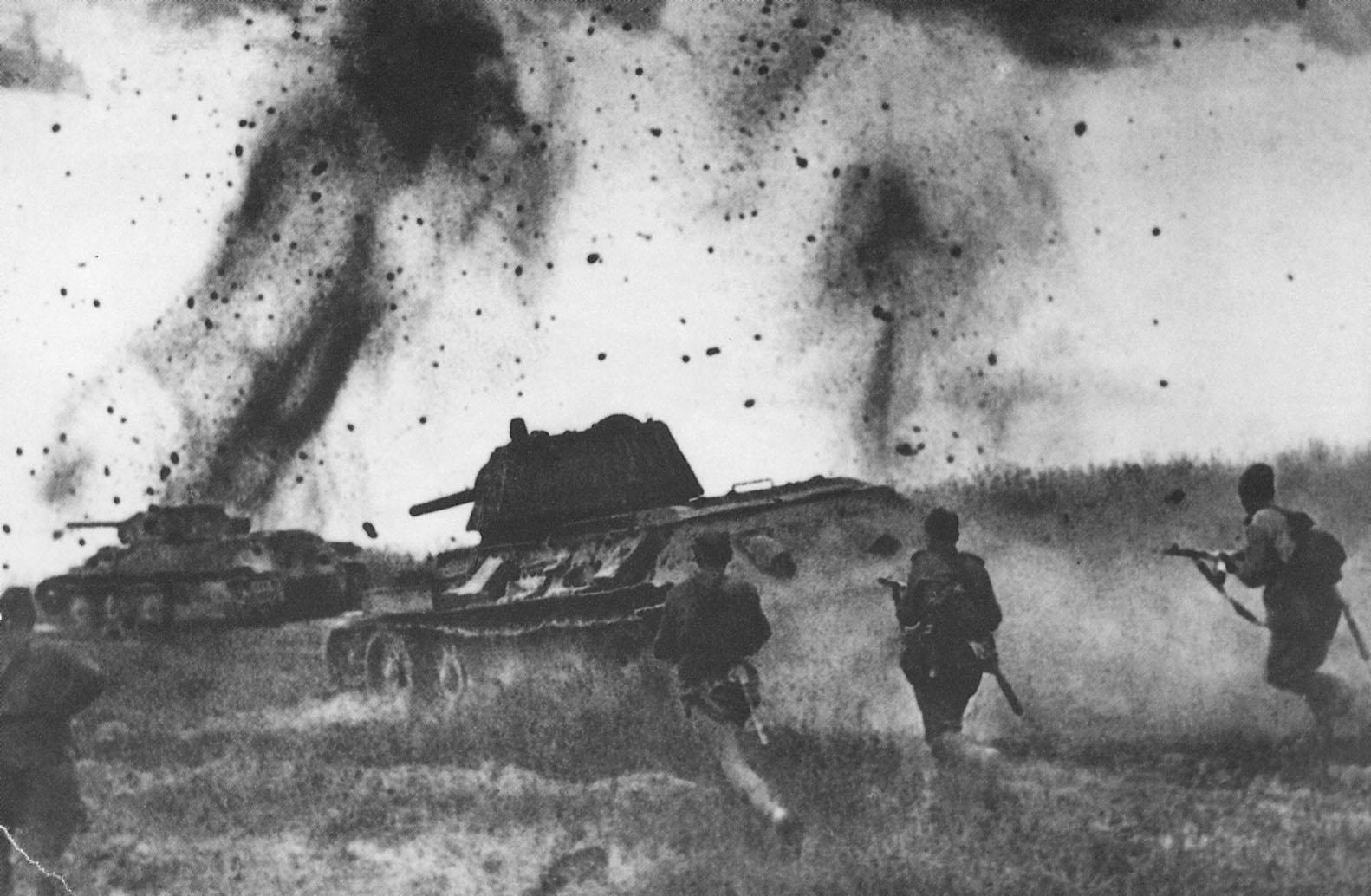 Soviet T-34 tanks and infantry assault German forces at the battle of Kursk.