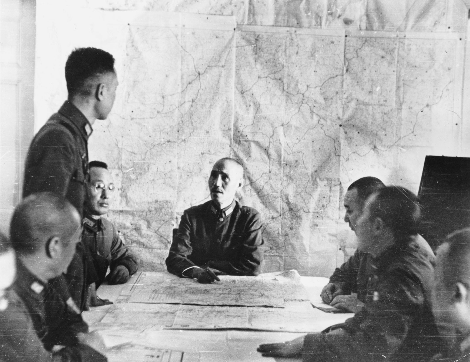 Chiang Kai-shek meeting with his staff during the Sino-Japanese War. (Encyclopædia Britannica Online)