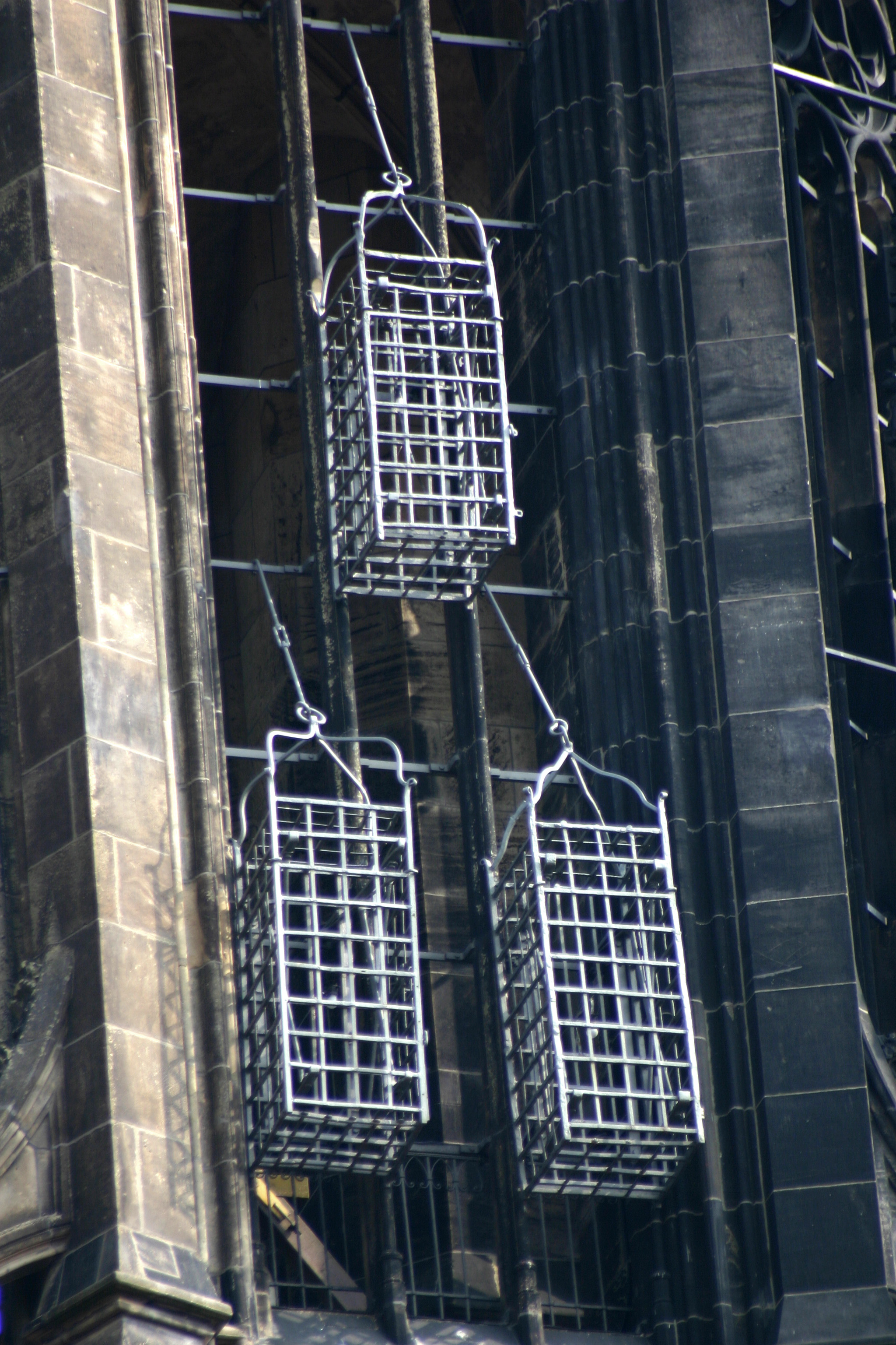 Cages of the leaders of the Münster Rebellion at the steeple of St. Lambert's Church (Photo by Rüdiger Wölk)