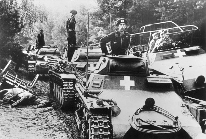 Poland, on the Brda river, with   Generaloberst Heinz Guderian in the command track to the right  .Panzer soldiers on German Panzer Is and Panzer IIs, along with a medium Schützenpanzer half-track.