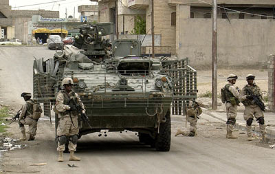 Soldiers dismount a Stryker Infantry Carrier Vehicle to conduct a patrol in Mosul, Iraq. (U.S. Army Photo)