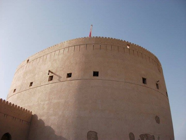 The Great Fort at Nizwa. Built in the 17th century, it is one of Oman's national landmarks. The scars from RAF rockets are still visible today (author's photo).