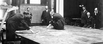 A Naval wargame on the third floor of Luce Hall, United States Naval War College, circa 1905–1906.