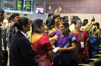 Indian Space Research Organization scientists and engineers cheer after India's Mars orbiter successfully entered the red planet's orbit, at their Spacecraft Control Center, in this photo taken through a glass panel, in the southern Indian city of Bangalore September 24, 2014. (Reuters, Abishek Chinnappa)
