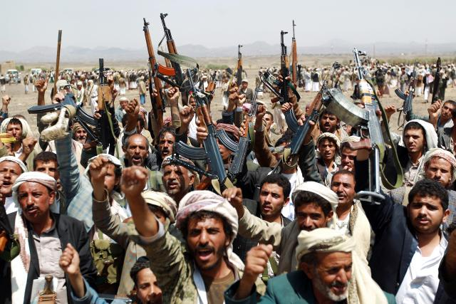 Armed supporters of the al-Houthi movement gather against al Qaeda militants.(Mohammed Huwais,  AFP )