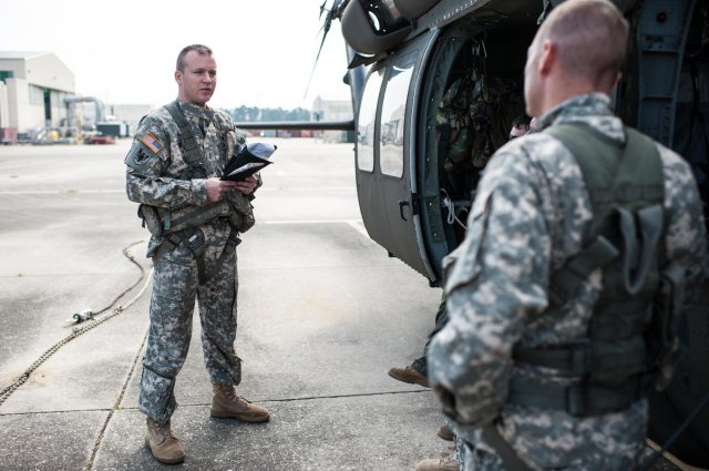 U.S. Army Reserve Chief Warrant Officer 2 Denver Gillham (left) conducts a pre-flight safety brief for a UH-60 Black Hawk helicopter at Simmons Army Airfield, Fort Bragg, N.C., Aug. 29, 2013.(Timothy Hale, U.S. Army Reserve Command)