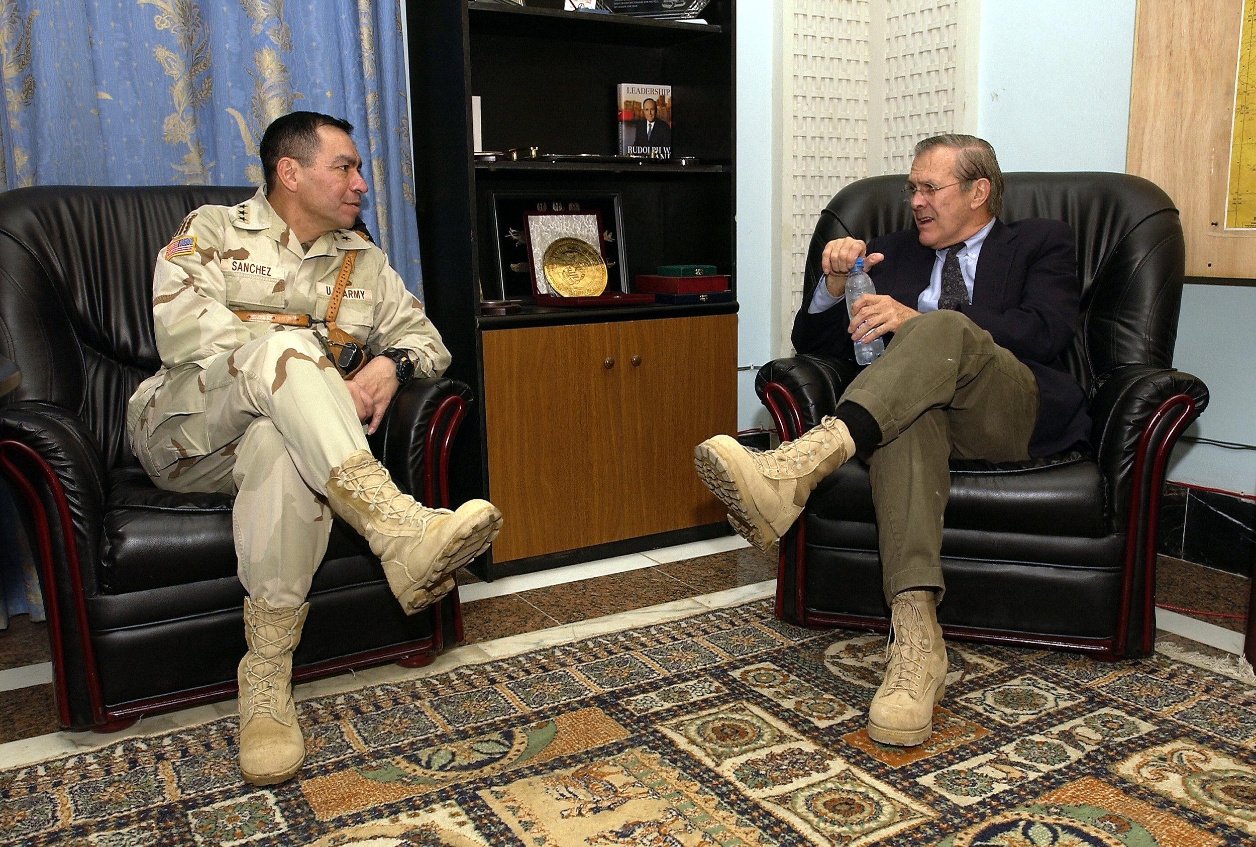 Secretary of Defense Donald H. Rumsfeld speaks with Army Lt. Gen. Ricardo Sanchez in Baghdad, Iraq, on Dec. 6, 2003 ( DoD Photo )