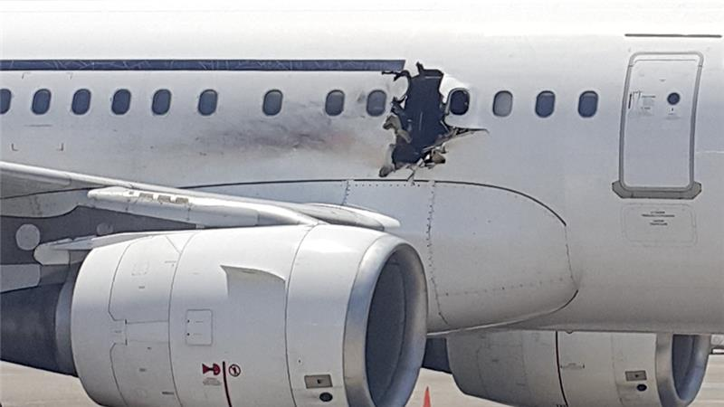 A one-meter hole in a Daallo Airlines aircraft, created by an explosion shortly after taking off from Mogadishu enroute to Djibouti. (AP Photo)