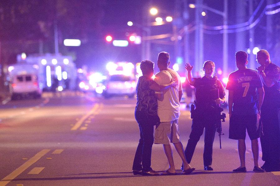 Orlando police officers direct family members away from the Pulse nightclub. (Phelan Ebenhack | AP)