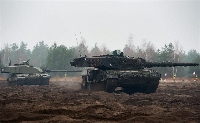 A British Challenger 2 main battle tank (left) with a Polish Leopard 2 tank on rough terrain in Poland. The U.K. will take on the role of lead nation in the VJTF in 2017, and on rotation thereafter. (SSgt Mark Nesbit/UK MoD Photo)